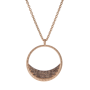 "Gold tone necklace with a circle pendant and gray pave stones. Approximately 32"" in length."