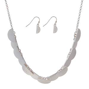 "Burnished silver tone necklace set featuring half circles and matching earrings. Approximately 16"" in length."