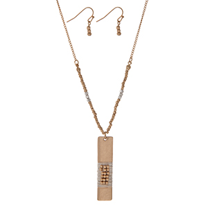 "Gold tone necklace set displaying a wire wrapped two tone rectangle pendant and matching fishhook earrings. Approximately 18"" in length."