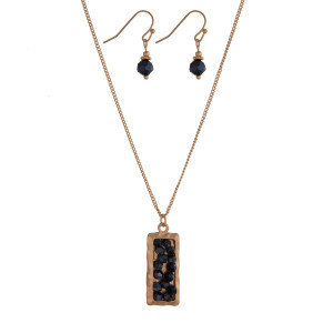 "Dainty gold tone necklace set with a rectangle pendant and hematite beads. Approximately 16"" in length."