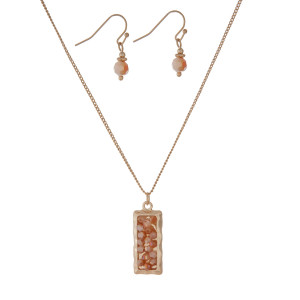 "Dainty gold tone necklace set with a rectangle pendant and champagne beads. Approximately 16"" in length."