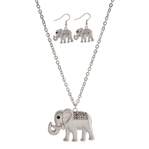 "Silver tone necklace set featuring an elephant pendant accented with gray rhinestones. Approximately 32"" in length."