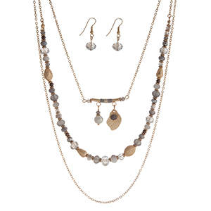 "Gold tone triple row necklace set with gray beads and a feather charm. Approximately 24"" in length."
