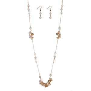 "Gold tone necklace set featuring pearl and clear faceted beads with sea life charms. Approximately 32"" in length."