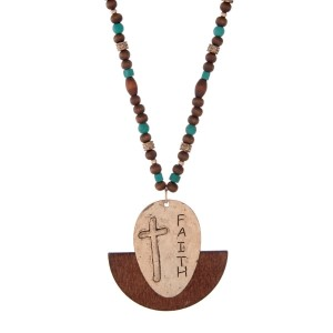 "Gold tone necklace with brown wooden beads and turquoise beads, displaying a spoon pendant stamped with ""FAITH"" and a cross. Approximately 32"" in length."