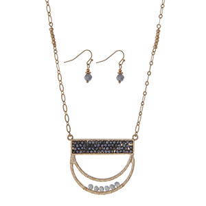 "Gold tone necklace set featuring a half circle pendant accented with gray beads. Approximately 32"" in length."