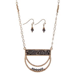 "Gold tone necklace set featuring a half circle pendant accented with silver beads. Approximately 32"" in length."