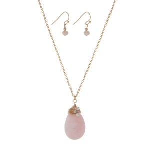"""Gold tone necklace set with a pale pink wire wrapped natural stone teardrop pendant and matching earrings. Approximately 24"""" in length."""