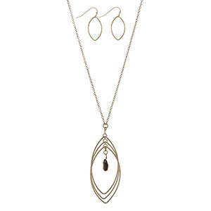 "Dainty gold tone necklace set featuring a teardrop pendant with a tigers eye stone. Approximately 32"" in length."