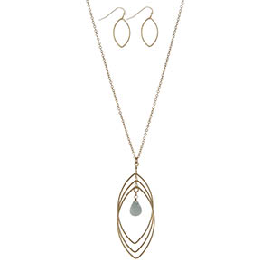 "Dainty gold tone necklace set featuring a teardrop pendant with a mint green stone. Approximately 32"" in length."