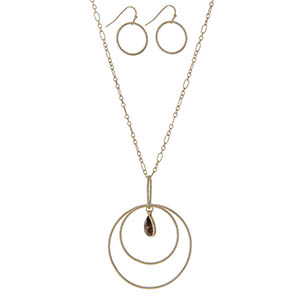 "Gold tone necklace featuring a circle pendant with a tigers eye teardrop natural stone. Approximately 32"" in length."