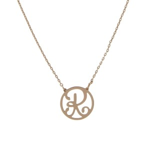 "Dainty gold tone necklace with a script ""R"" pendant. Approximately 16"" in length."