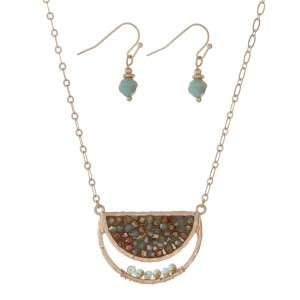 "Gold tone necklace set with a half circle shape and turquoise beads. Approximately 16"" in length."