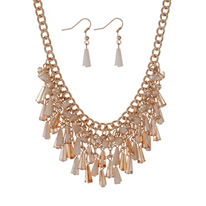 "Gold tone necklace set featuring ivory and champagne beaded fringe and matching fishhook earrings. Approximately 18"" in length."