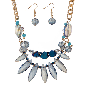 "Gold tone necklace set displaying blue glass beads and matching fishhook earrings. Approximately 18"" in length."