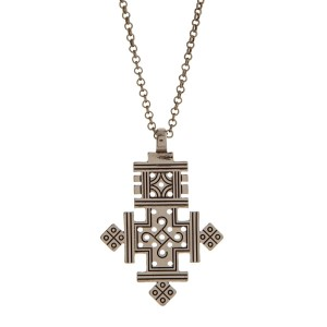 "Burnished gold tone necklace with a cross pendant. Approximately 32"" in length."