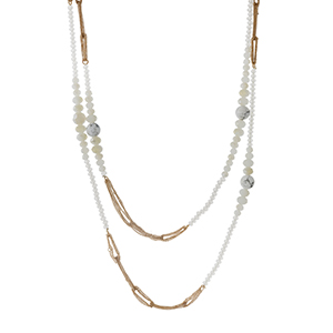 "Gold tone double layer necklace with howlite and white opal beads. Approximately 30"" in length."