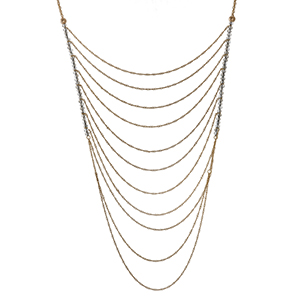 "Gold tone multi layer necklace with gray iridescent beads. Approximately 32"" in length."
