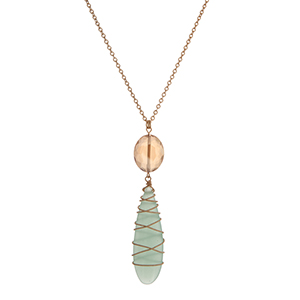"""Gold tone necklace with a faceted topaz stone and a wire wrapped mint teardrop stone. Approximately 32"""" in length."""