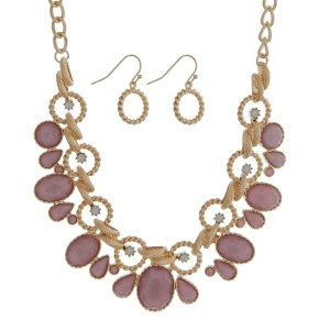 """Gold tone necklace set with pink faceted stones and white opal rhinestones. Approximately 16"""" in length."""