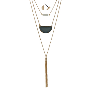 "Gold tone triple layer necklace with a dark green stone and a chain tassel. Approximately 32"" in length."