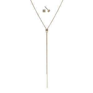 "Dainty gold tone necklace set with clear rhinestones. Approximately 32"" in length."