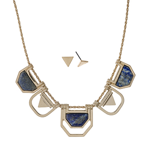 "Gold tone necklace set with geometric shapes and blue stones. Approximately 18"" in length."