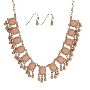 "Gold tone necklace set with rose pink oval stones and matching fishhook earrings. Approximately 18"" in length."