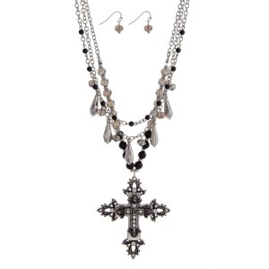 "Burnished silver tone necklace set featuring black beads and a cross pendant. Approximately 32"" in length."