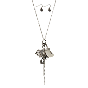 """Silver tone necklace set with elephant, horn and tassel pendant charms. Approximately 32"""" in length."""