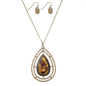 "Gold tone necklace set with a teardrop tortoise pendant and matching fishhook earrings. Approximately 32"" in length."
