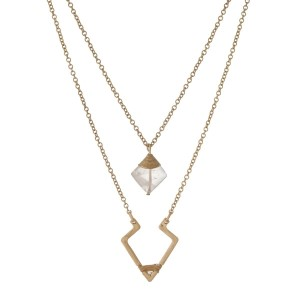 """Gold tone double layer necklace with a triangle and beige pendant. Approximately 18"""" in length."""