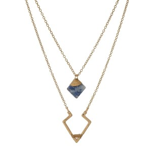 "Gold tone double layer necklace with a triangle and blue lapis pendant. Approximately 18"" in length."