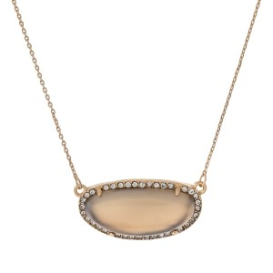 """Gold tone necklace with a gray stone surrounded by clear rhinestones. Approximately 18"""" in length."""