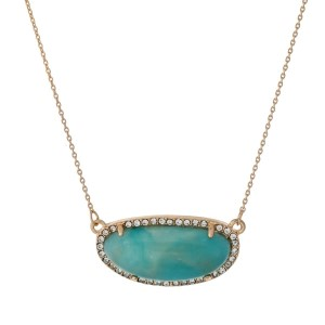 """Gold tone necklace with a mint stone surrounded by clear rhinestones. Approximately 18"""" in length."""