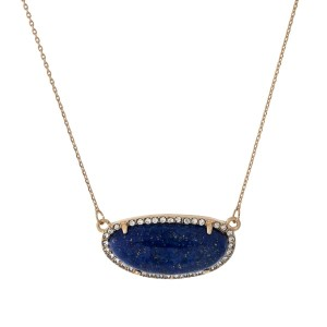 "Gold tone necklace with a blue stone surrounded by clear rhinestones. Approximately 18"" in length."
