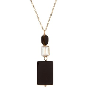 "Gold tone necklace with black and clear wire wrapped square stones. Approximately 24"" in length."