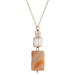 "Gold tone necklace with peach and clear wire wrapped square stones. Approximately 24"" in length."