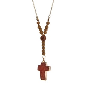 """Gold tone necklace with wooden beads and an orange druzy stone cross pendant. Approximately 18"""" in length."""