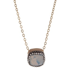 """Dainty gold tone necklace with a white opal square stone pendant. Approximately 16"""" in length."""