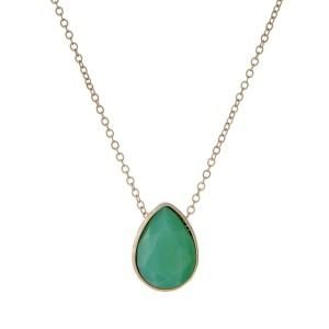 "Dainty gold tone necklace with a mint green teardrop stone. Approximately 16"" in length."