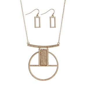"""Gold tone necklace set with a geometric circle pendant. Approximately 16"""" in length."""