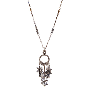 "Silver tone necklace with snowflake charms. Approximately 24"" in length."