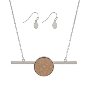 "Silver tone necklace set with a two tone circle and bar pendant. Approximately 16"" in length."