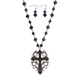 """Silver tone necklace set with black beads and a cross pendant. Approximately 28"""" in length."""