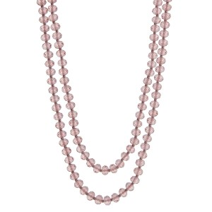"""Light pink beaded wrap necklace. Approximately 60"""" in length."""