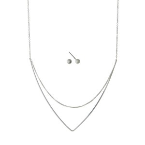 "Dainty silver tone necklace set with a layered triangle pendant. Approximately 18"" in length."