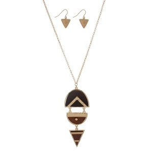 "Gold tone necklace set with a wooden geometric pendant. Approximately 32"" in length."
