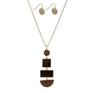"Gold tone necklace with a wooden geometric pendant. Approximately 32"" in length."