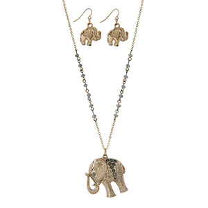 "Gold tone necklace set with gray beads and an elephant pendant. Approximately 32"" in length."